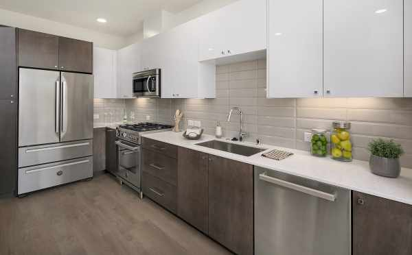 Kitchen with Quartz Counters and Stainless Steel Appliances in the Avani Townhomes