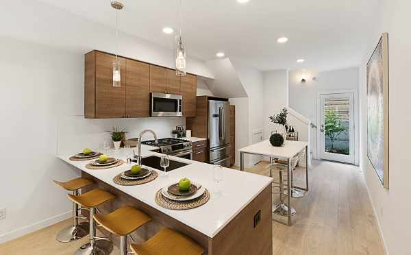 Kitchen with Bar Seating in One of the Lucca Townhomes Now Selling in Wallingford