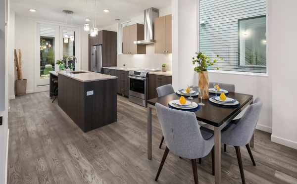 Dining Area and Kitchen in One of the Units in Oncore Townhomes