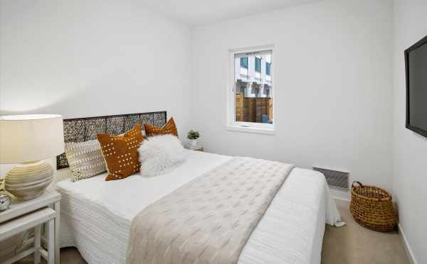 First-Floor Bedroom at 6317C 9th Ave NE, One of the Homes in Zenith Towns North by Isola Homes