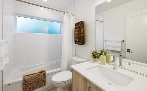 First-Floor Bathroom at 6317E 9th Ave NE in Zenith Towns North by Isola Homes