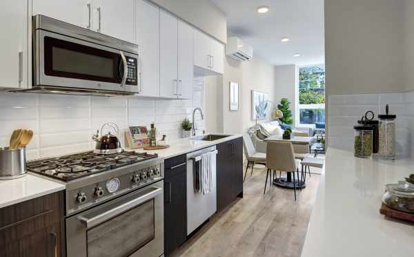View from the Kitchen to the Dining Area in One of the Emory Townhomes in Green Lake