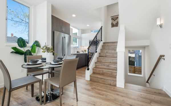 Dining Room and Kitchen at 1113A 14th Ave, One of the Corazon North Townhomes in Capitol Hill by Isola Homes