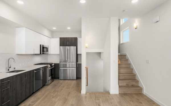 View of the Kitchen and the Stairs at 323 Malden Ave E