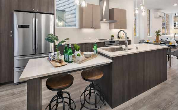 The Kitchen with Bar Seating in One of the Units in Oncore Townhomes