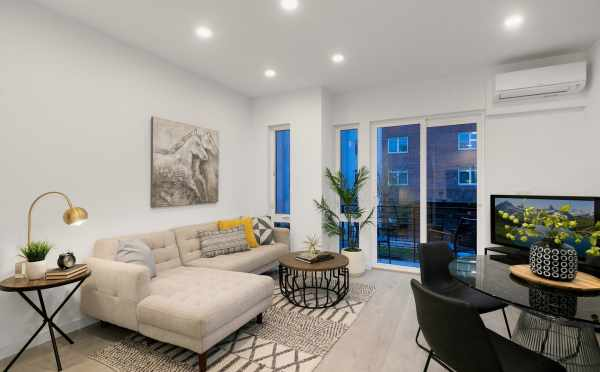 Living Room and Dining Area at 109A 22nd Ave, One of the Thalia Townhomes by Isola Homes