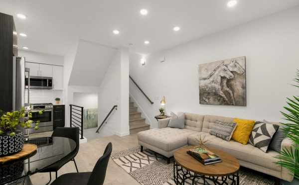 View from the Living Room and Dining Area to the Stairs at 109A 22nd Ave E