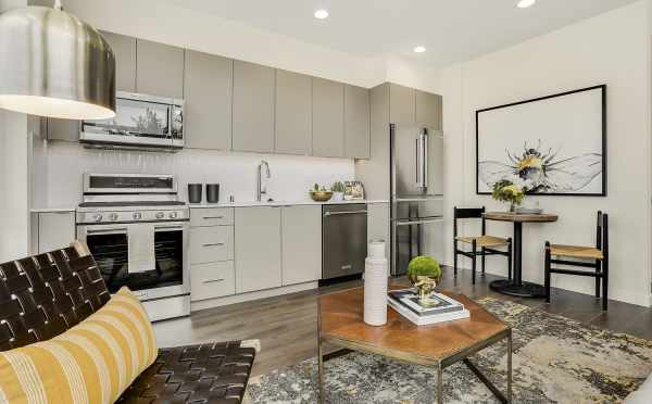 View of the Dining Area and Kitchen from the Living Area at 8364 14th Ave NW, One of the Thoren Townhomes in Crown Hill