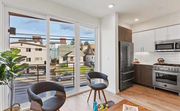 Living Room and Kitchen at 7213 5th Ave NE in Verde Towns 3 by Isola Homes