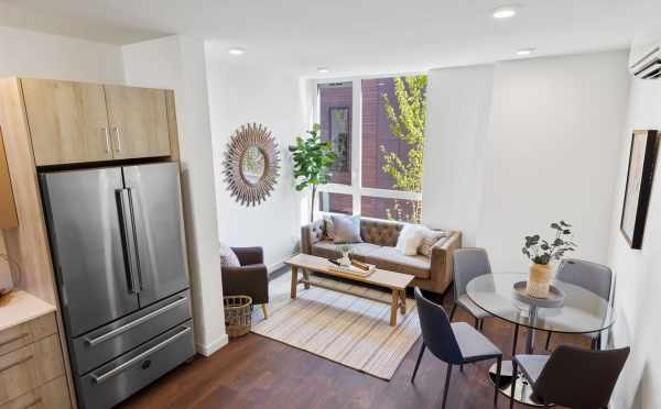 View of the Kitchen, Dining Area, and Living Room at 6317E 9th Ave NE