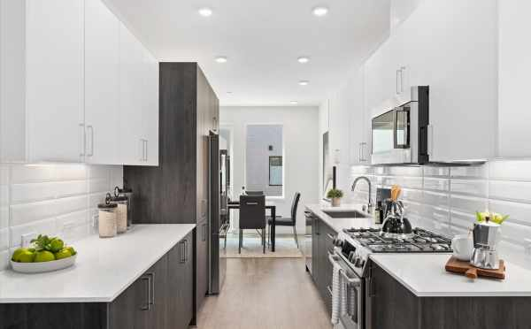 View from the Kitchen to the Dining Room at 212E 18th Ave in the Cabochon Collection by Isola Homes