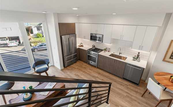 View from the Stairs to the Kitchen and Living Room at 7213 5th Ave NE in Verde Towns 3