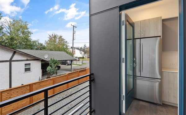 View from the Deck to the Kitchen at 10843 11th Ave NE, One of the Lily Townhomes by Isola Homes