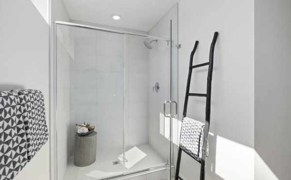 Shower in the Owner's Suite Bathroom at 6309F 9th Ave NE, One of the Homes in Zenith Towns East