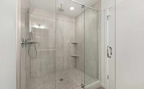 Large, Tiled Shower with Overhead Shower Head in the Twin I Townhomes